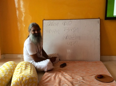Yogi Sivadas writes our names in Sanskrit
