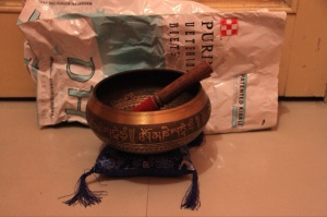 Re-use, recycle, repurpose. Cat food bag becomes packing for Tibetan bowl.